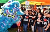 Children play with a dragon dancer