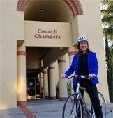 San Mateo Mayor Diane Papan on a bicycle.