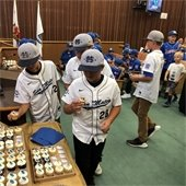 Youth ball players eat cupcakes at council celebration