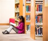 A child reading in the library