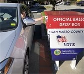 Woman drives by ballot box
