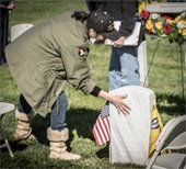 Woman touching gravestone
