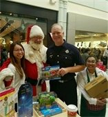 Firefighter and Santa at Hillsdale Shopping Center