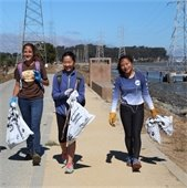 Volunteers walk along the coastal trail at the Bayfront cleanup