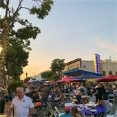 Sunset over people enjoying downtown event