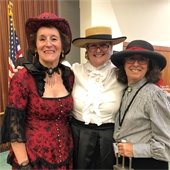 Staff dressed in costumes from the 1800s