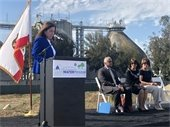 Mayor Diane Papan speaking on stage at the wastewater treatment plant