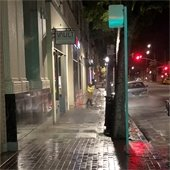 A worker cleans sidewalks in Downtown San Mateo