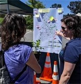 People look at a map of San Mateo