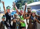 A family covered in mud after obstacle course challenge