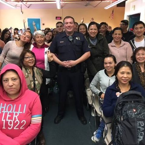 Police officer with community group.