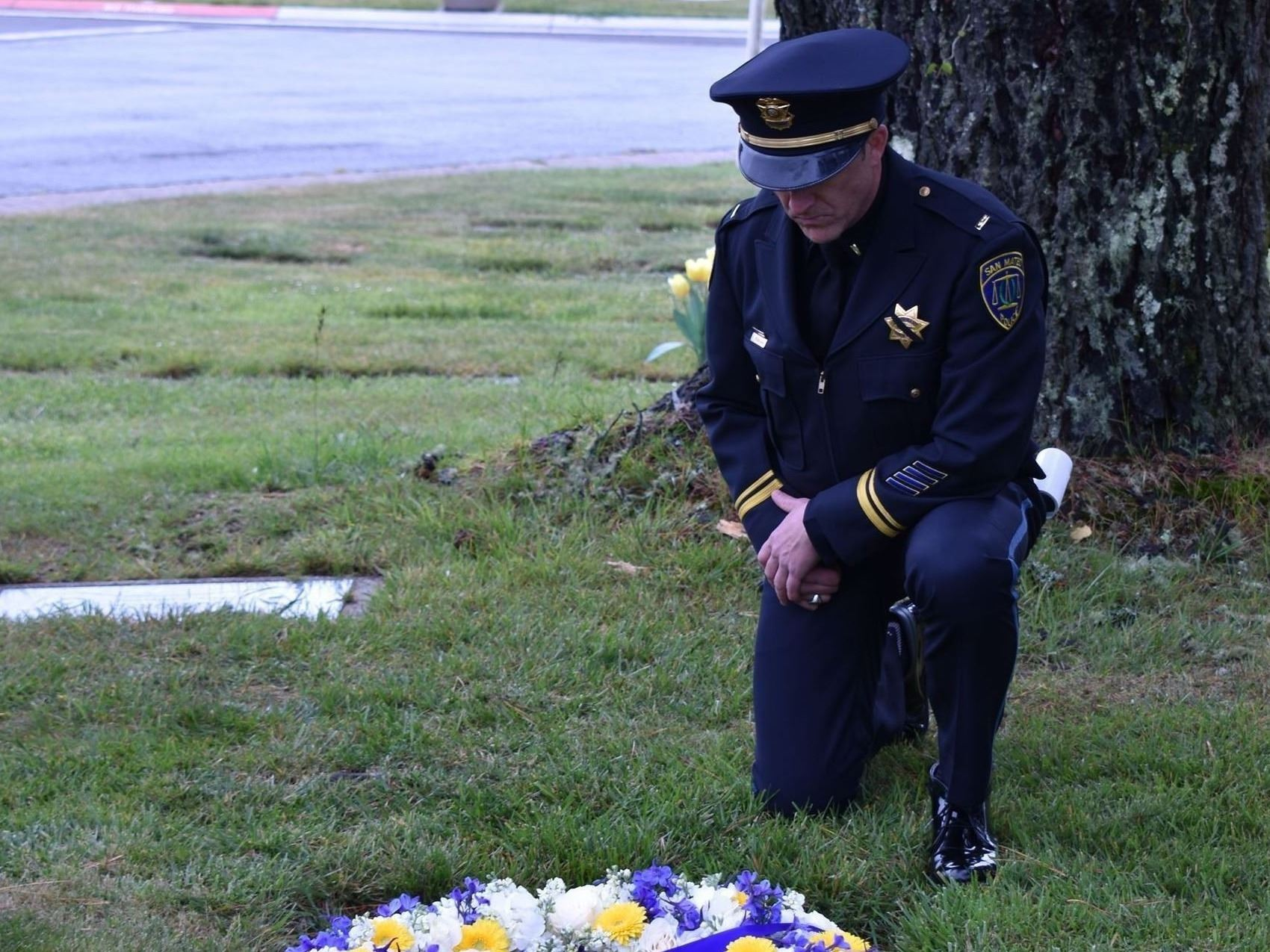 Officer at grave site of Sgt. Joinville.