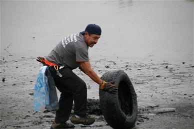 Bayfront Cleanup, man with tire